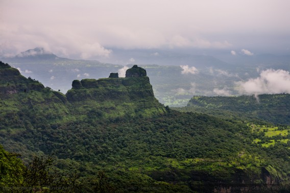 View of Padargad, covered in a dense green tropicl forest in the monsoon on the trek to Bhimashankar, part of the Western Ghats in Maharashtra.