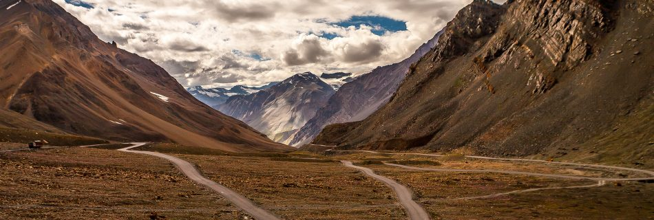 Hair pin curve on the mountain pass Baralacha la in the middle of the golden brown mountain of the Greater Himalayas on the Leh Manali highway connecting Ladakh to Himachal in India.