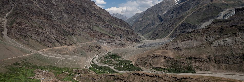 Green Suru valley view with cultivated farms and solar power from a trek in Parkachik, last village in Suru valley on the way to offbeat and adventurous Zanskar in North India