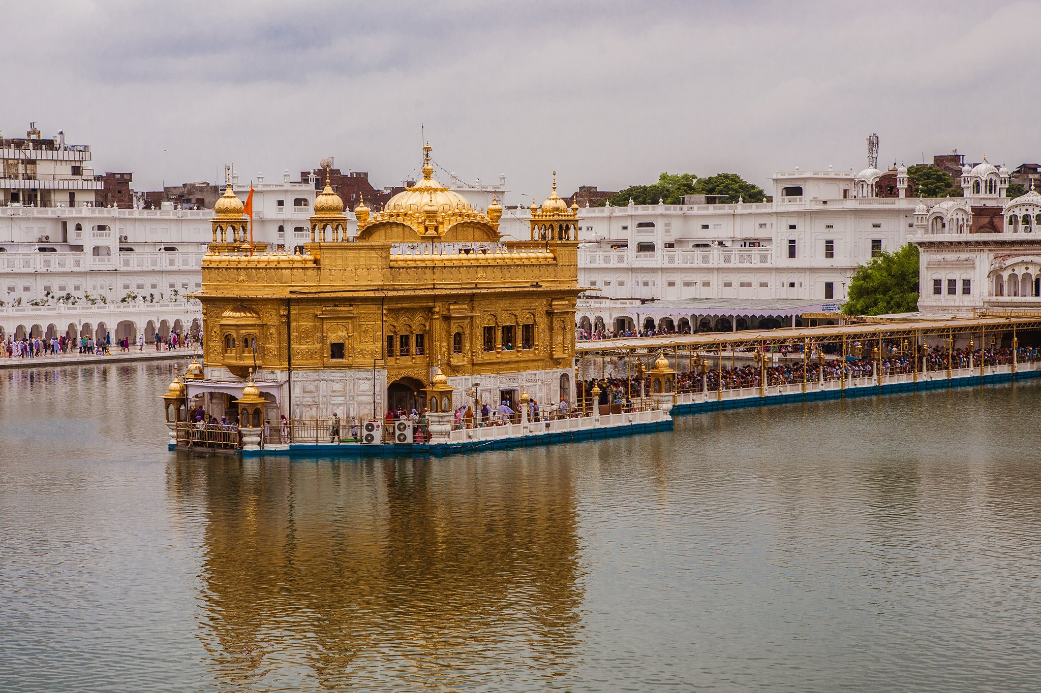 Long queues are seen at the main entrance of the Golden Temple in Amritsar, the most important gurudwara for the Sikhs, made in gold and surrounded by a holy lake.