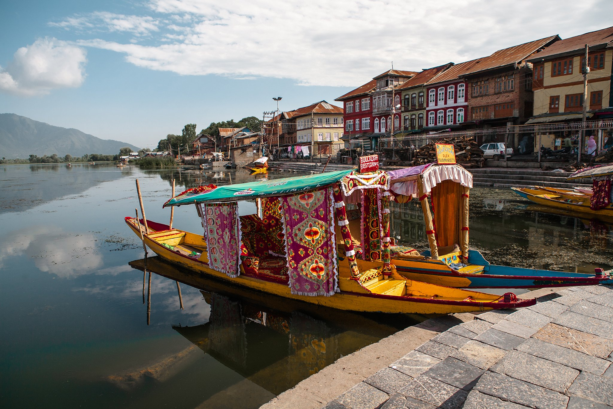 Shikara, a type of boat used in Kashmir for transportation in water is a major tourist attraction of Dal Lake in Kashmir where tourists are given rides in the Dal lake in Shikaras decorated with colourful fabrics and bright colours.