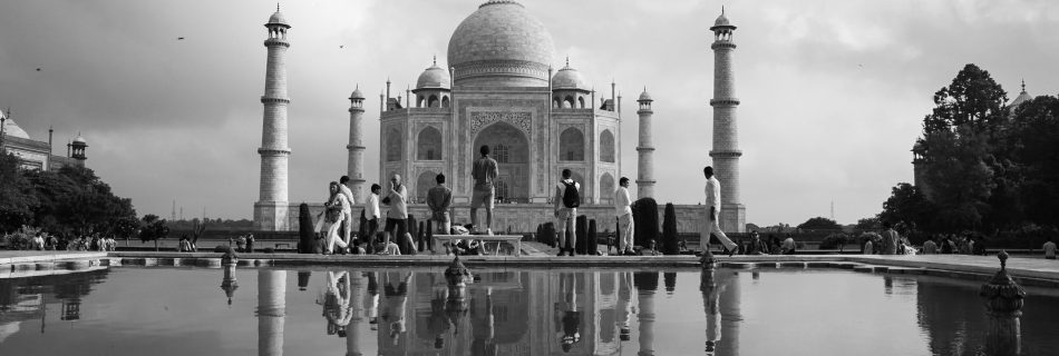 A monochrome shot of full front look with its reflection cast in the pool of the Taj Mahal, a UNESCO world heritage site in Agra, India.