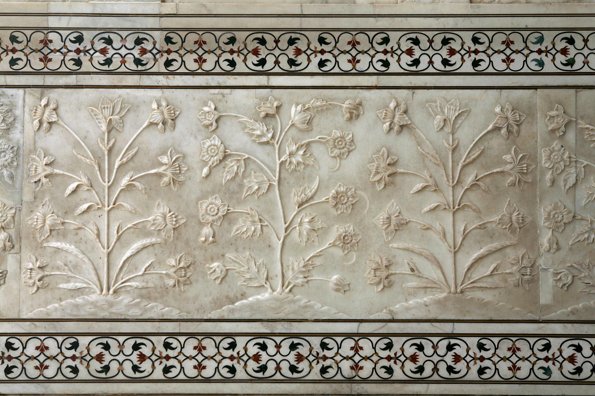 Delicate floral carving in marble and studded with precious gems at the UNESCO world heritage site, the Taj Mahal in Agra, India.